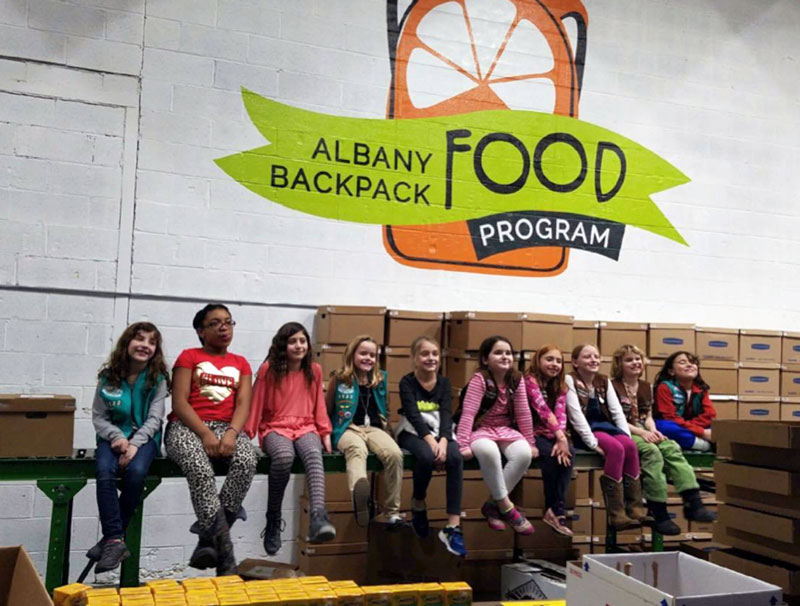 Girlscouts lined up to help pack backapacks