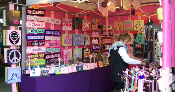 woman browsing at a craft booth