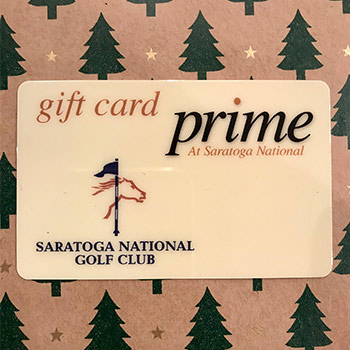 gift card on top of christmas tree paper