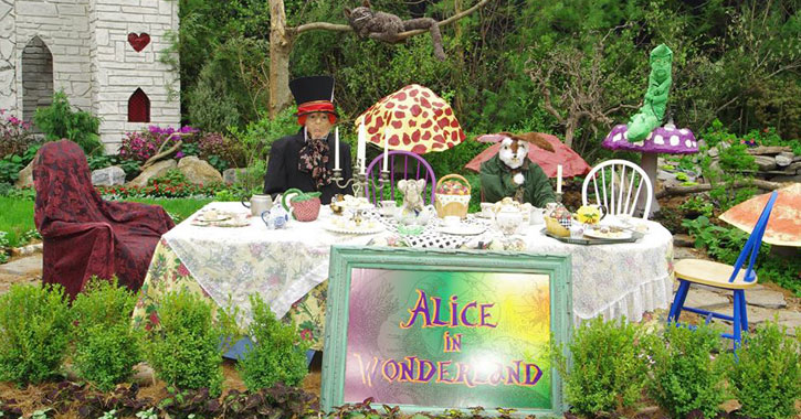 an Alice in Wonderland-themed garden display