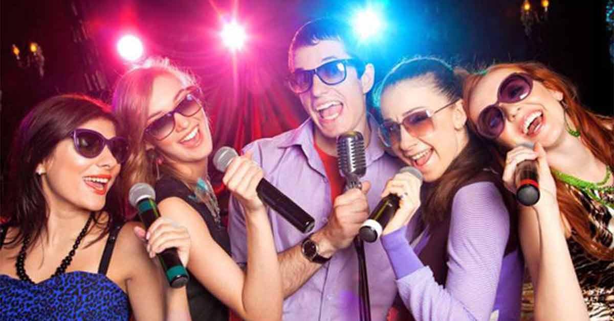 four people doing karaoke