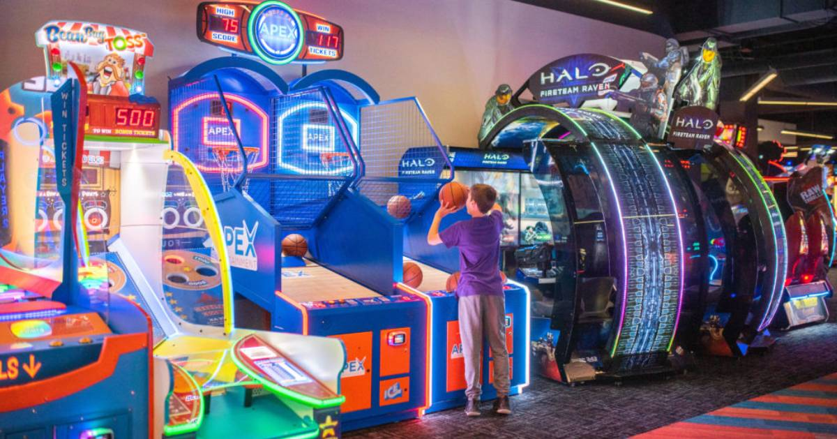 boy shooting basketball in an arcade game