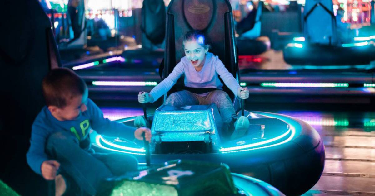 boy and girl in bumper cars