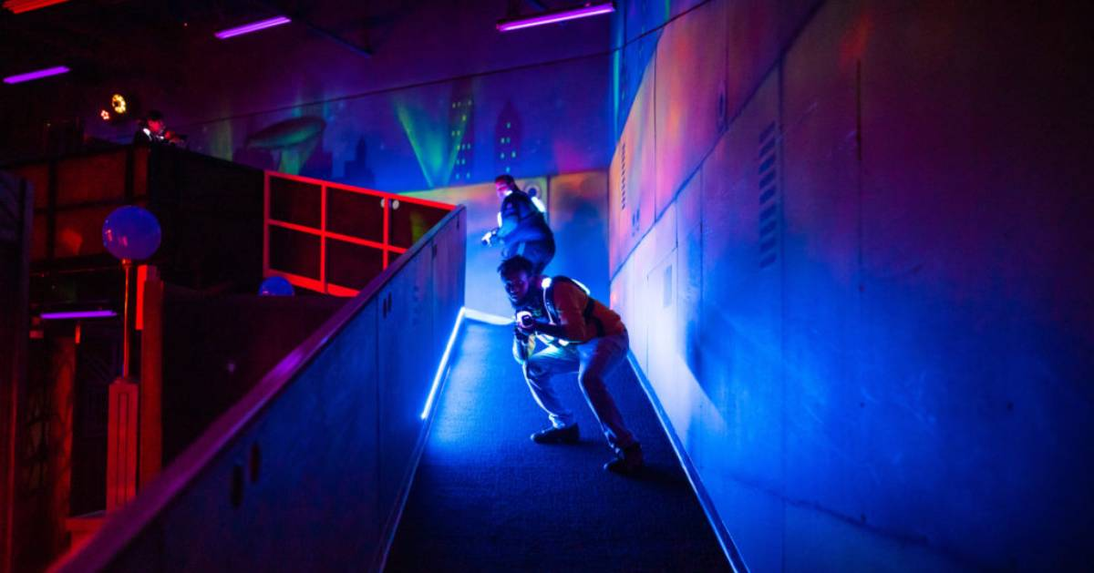 two people on a ramp in a laser tag arena