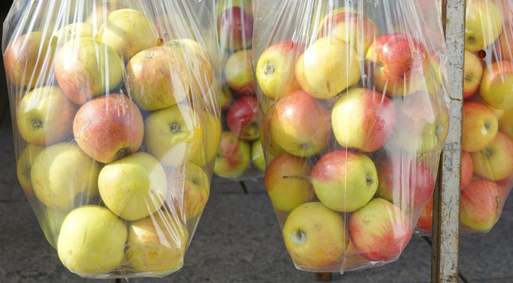 large plastic bags of apples