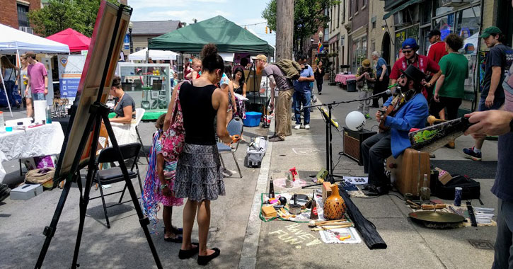 art vendors and live music on the street