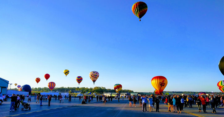 people at the Adirondack Balloon Festival, balloons going up