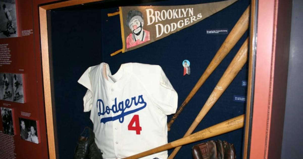 dodgers shirt and baseball bats on display