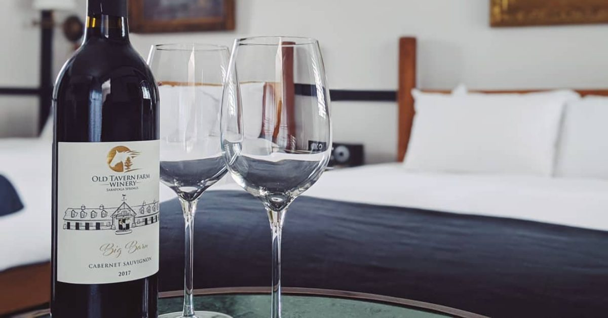 wine glasses and wine bottles in a hotel room