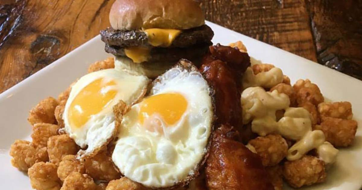eggs on home fries with a burger