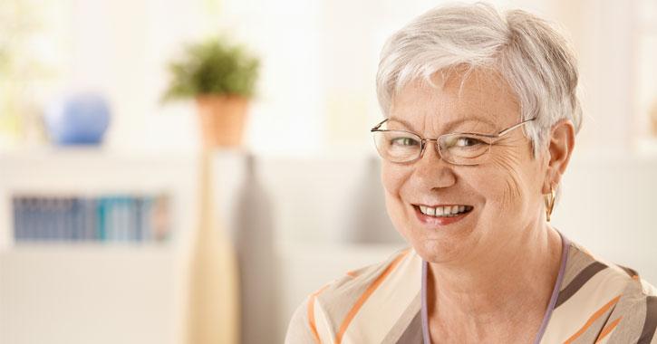 older woman near plant