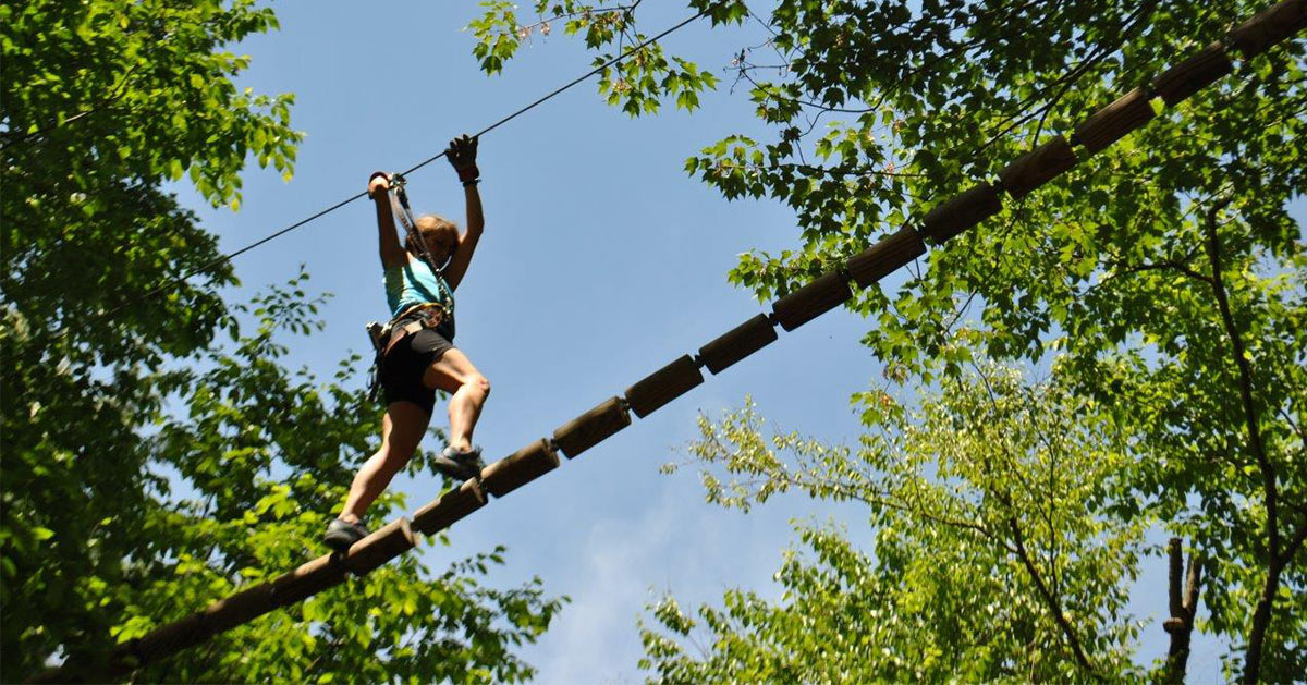 girl traversing an aerial obstacle