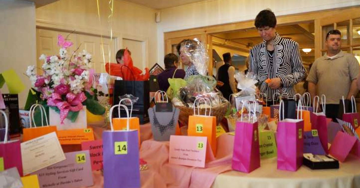 woman looking down at colored bags at a fundraising event