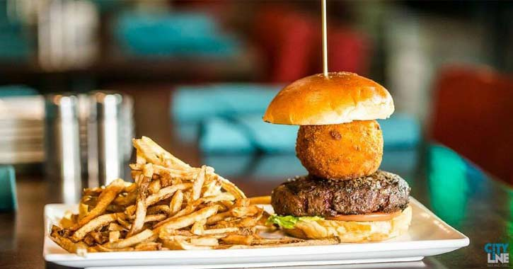 a burger with a fried mac and cheese ball