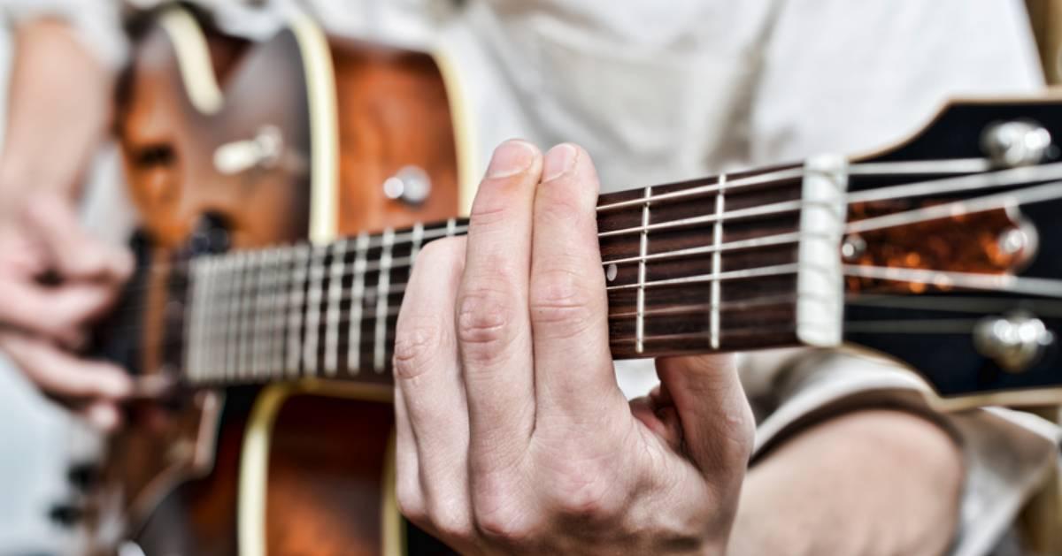 a guitar player close up