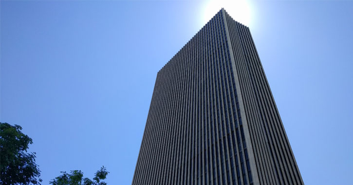 view looking up at the Corning Tower, blue sky