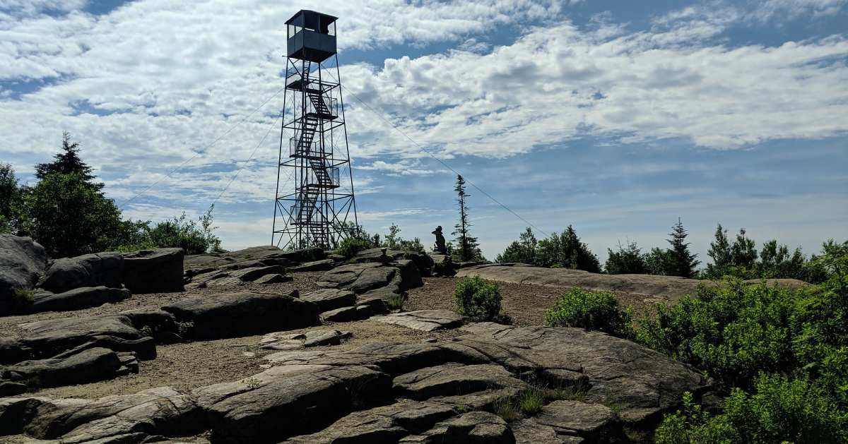 fire tower on a rocky summit