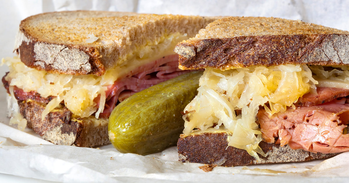 reuben sandwich with a pickle