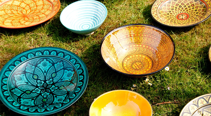 several ceramic bowls on a lawn