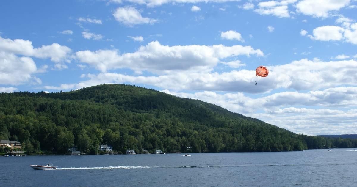 boat pulling a parasail