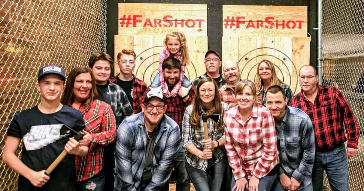 group of people at axe-throwing place