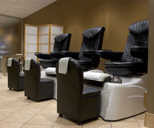 foot massage chairs at a spa