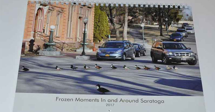 calendar with photo of ducks crossing a road