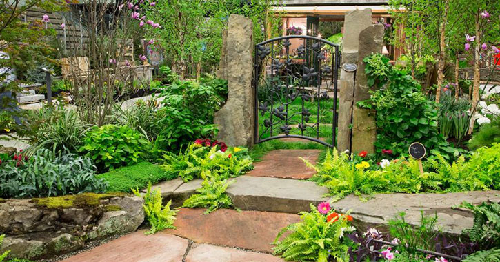 a beautiful garden display with a gate