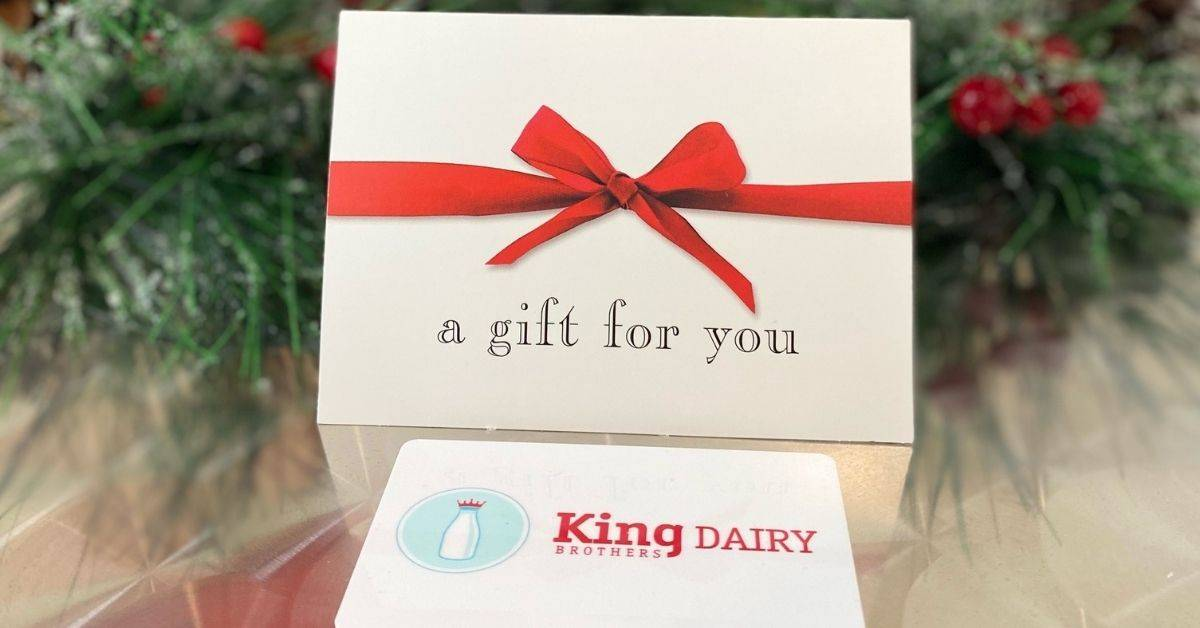 a king brothers dairy gift card and a card that reads a gift for you