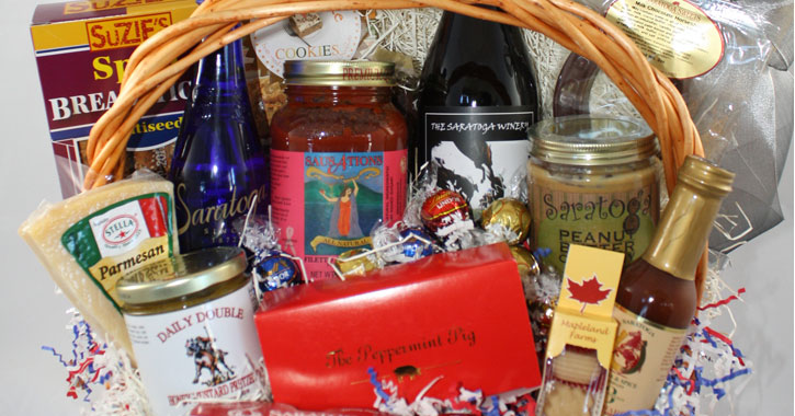 gift basket of food items with holiday bow