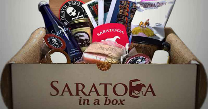 image divided image with a Saratoga box on the left filled with Saratoga items and a the USPS package at a royal blue door on the right