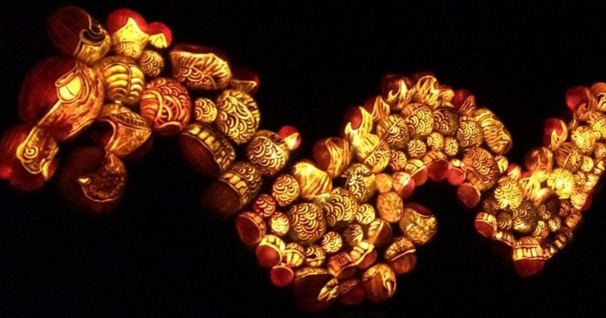 a glowing dragon made of jack o lanterns