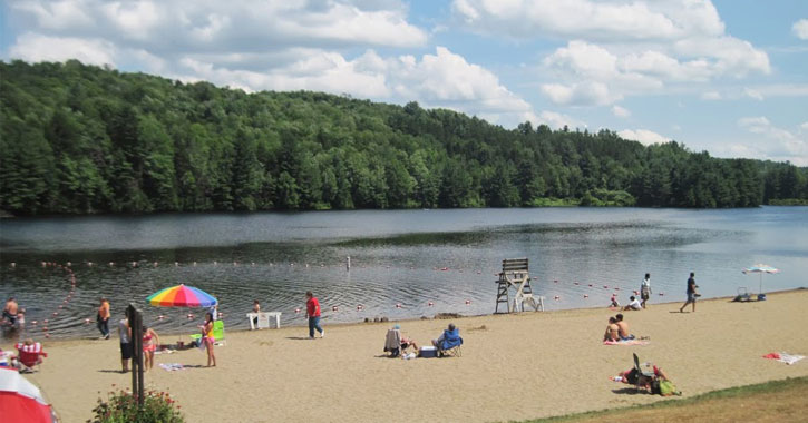 a beach on a lake with people