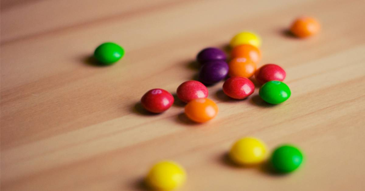 several Skittles spread out on a table