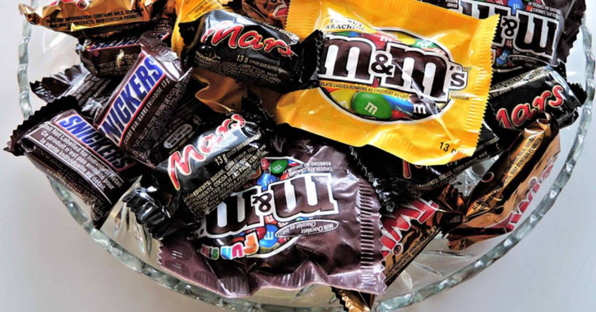 a bowl of Halloween candy, pretty much all chocolate