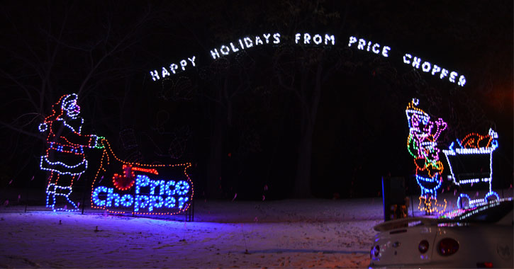 holiday lights spelling out Happy Holidays From Price Chopper, there is a Santa with a bag that says Price Chopper
