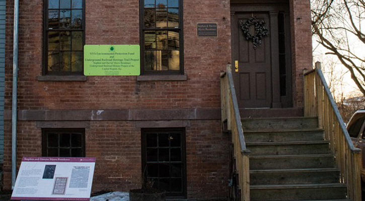 a historic house with informative information posted