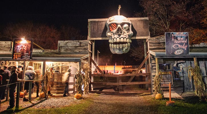 the entrance to Double M Haunted Hayrides with a giant skull