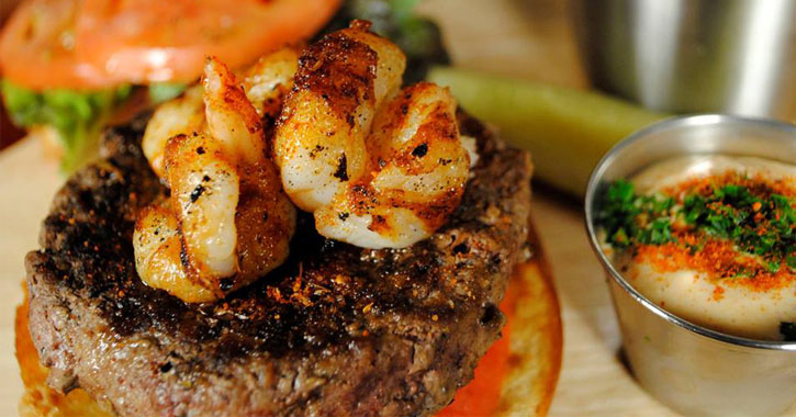 a burger with shrimp on it