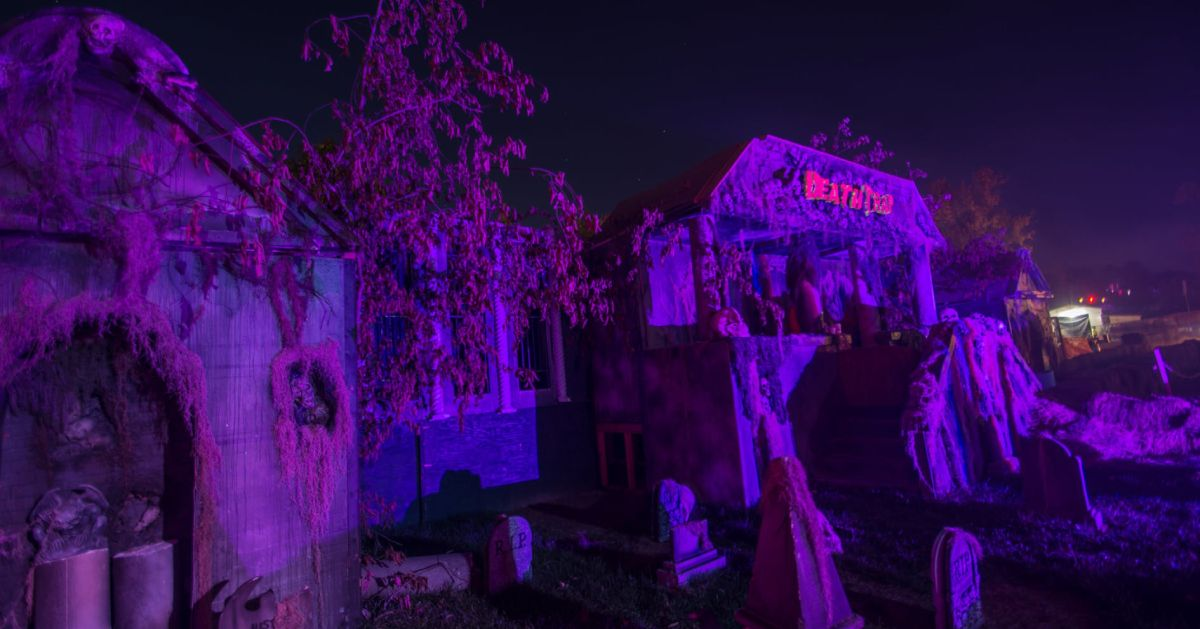 haunted graveyard with purple lighting