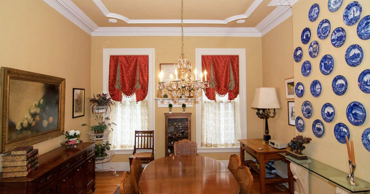 the inside of a dining area of a historic home