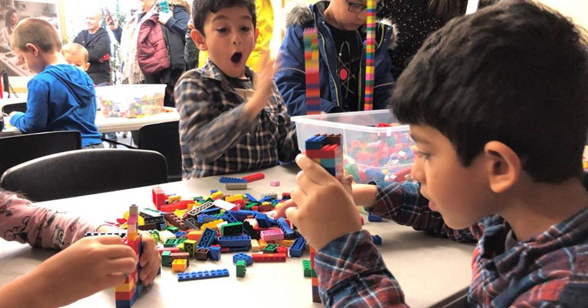 boys building with lego bricks