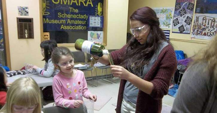 Children performing experiment at museum of innovation and science