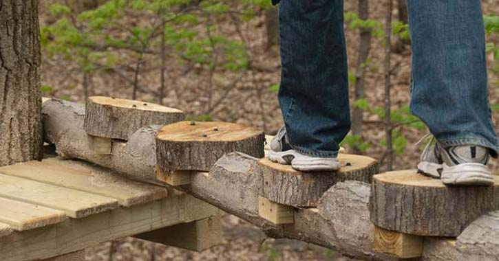 feet standing on wooden obstacle