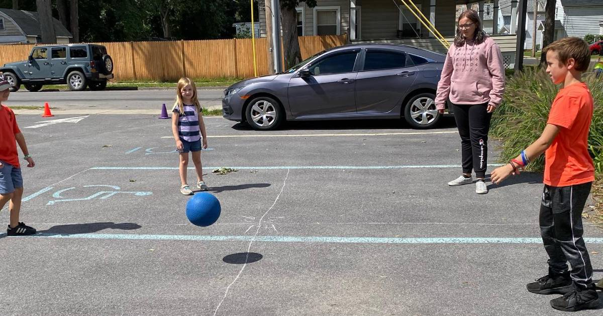 kids playing what looks like four square