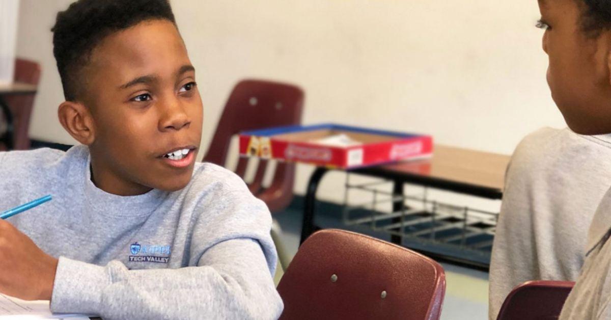 a boy at a classroom table