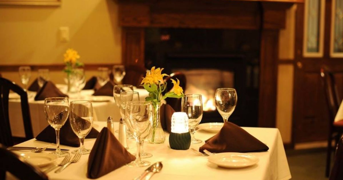 dining tables near fireplaces in a restaurant