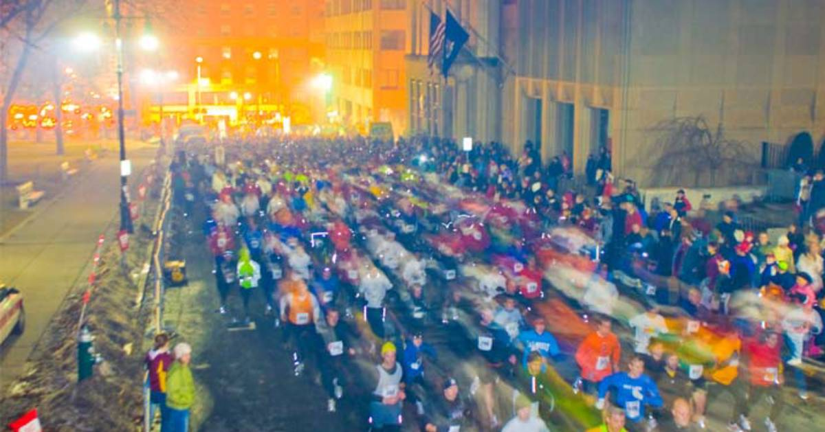people running in a race in the evening