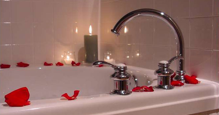 rose petals on a bathtub
