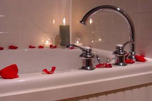 bathtub with rose petals